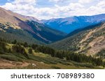View on a mountains and hills with green grass on it and blue sky. Colorado. Mountain Evans. Denver. USA - stock photo