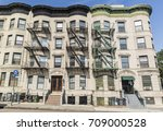a large apartment buildings on  ... | Shutterstock . vector #709000528