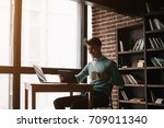 young man drawing template for...