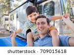 happy young caucasian father... | Shutterstock . vector #709015618