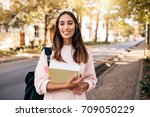beautiful young woman with book ... | Shutterstock . vector #709050229