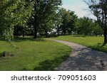 pathway through green trees at...   Shutterstock . vector #709051603