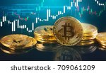 Bitcoins and New Virtual money concept.Gold bitcoins with Candle stick graph chart and digital background.Golden coin with icon letter B.Mining or blockchain technology - stock photo