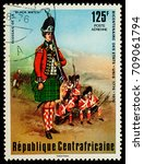"Small photo of Moscow, Russia - September 05, 2017: A stamp printed in Central African Empire, shows Scots of the ""Black Watch"", series ""The 200th Anniversary of American Revolution"", circa 1976"