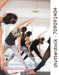 group asian women stretching... | Shutterstock . vector #709091404
