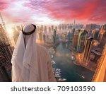 arabian man watching  dubai...   Shutterstock . vector #709103590