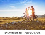 happy couple goes on a mountain ... | Shutterstock . vector #709104706