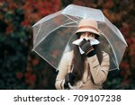 sick woman holding  umbrella in ... | Shutterstock . vector #709107238
