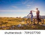 biker couple with mountain bike ... | Shutterstock . vector #709107700