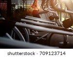 sportive asian woman running... | Shutterstock . vector #709123714
