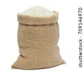 white rice in sack bag isolated ... | Shutterstock . vector #709146970