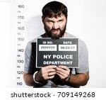 bearded man in handcuffs holds...   Shutterstock . vector #709149268