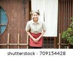 bowing asian woman | Shutterstock . vector #709154428