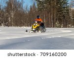 athlete on a snowmobile moving... | Shutterstock . vector #709160200