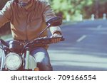 man riding motorbike on a road... | Shutterstock . vector #709166554