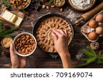 cooking christmas pastry. young ...   Shutterstock . vector #709169074