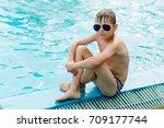 beautiful boy in a swimsuit... | Shutterstock . vector #709177744