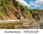 cold mountain river with ice on ... | Shutterstock . vector #709231429