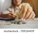 business woman picking coins... | Shutterstock . vector #709234459
