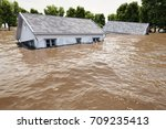 flooding houses with rising...   Shutterstock . vector #709235413