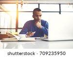 pensive international afro... | Shutterstock . vector #709235950