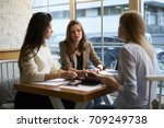 concentrated young designers... | Shutterstock . vector #709249738