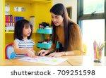 asian lady teacher teach about... | Shutterstock . vector #709251598