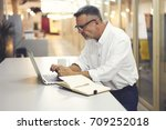 matured male graphic designer... | Shutterstock . vector #709252018
