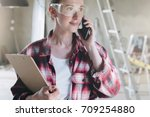 young businesswoman builder ... | Shutterstock . vector #709254880