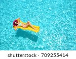 beautiful young girl relaxing... | Shutterstock . vector #709255414