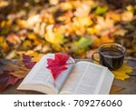 hot coffee and red book with... | Shutterstock . vector #709276060