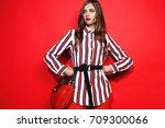 fashion portrait of beautiful... | Shutterstock . vector #709300066