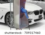 electric car charging on... | Shutterstock . vector #709317460