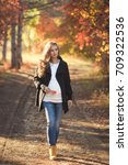 young pregnant woman walking in ... | Shutterstock . vector #709322536