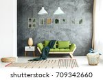 dark green blanket thrown on... | Shutterstock . vector #709342660
