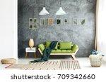 dark green blanket thrown on... | Shutterstock . vector #709342660