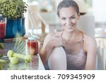 smiling fit woman sitting on... | Shutterstock . vector #709345909