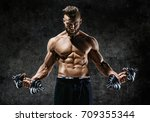 powerful bodybuilder doing the... | Shutterstock . vector #709355344