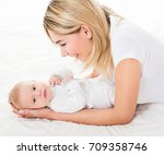 mother and baby playing and... | Shutterstock . vector #709358746