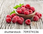 raspberry on a old wooden... | Shutterstock . vector #709374136
