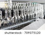 empty glass bottles on the... | Shutterstock . vector #709375120