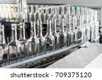 empty glass bottles on the... | Shutterstock . vector #709375120