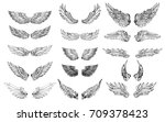Stock vector hand drawn wing set sticker wing tattoo doodle and sketch style wing of bird tattoo 709378423