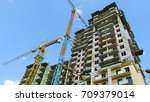 two cranes near buildings | Shutterstock . vector #709379014