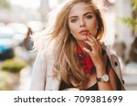 romantic young woman with red... | Shutterstock . vector #709381699