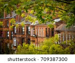 row of red sandstone tenement... | Shutterstock . vector #709387300