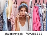 crying woman wiping her face... | Shutterstock . vector #709388836