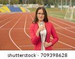 pretty journalist is reporting... | Shutterstock . vector #709398628