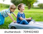 two happy children playing with ... | Shutterstock . vector #709402483