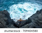 young man stands on a rock and... | Shutterstock . vector #709404580